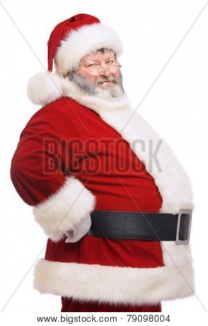 Santa Claus is standing sideways. Isolated over white.
