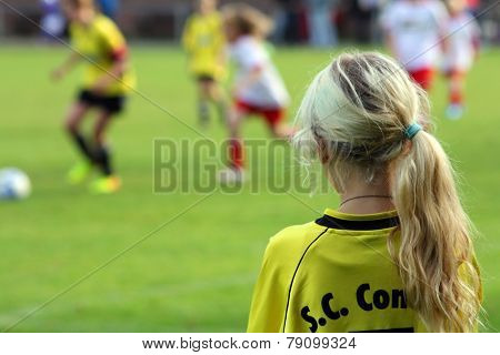 The Girl The Football Player On A Football Field