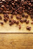picture of coffee coffee plant  - Coffee beans on wooden background - JPG