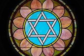 foto of stained glass  - Colorful stained glass image of a Star of David in a synagogue - JPG