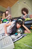 stock photo of pouting  - Pouting 1960s lady with friends and telephone - JPG