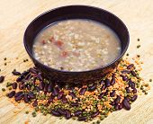 stock photo of mixture  - mess of pottage in bowl and beans mixture on wooden plate - JPG
