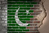 pic of pakistani flag  - Dark brick wall texture with plaster  - JPG