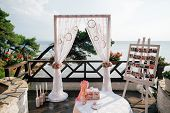 picture of adornment  - vintage wedding arch with wedding decoration and sea view - JPG
