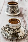 picture of traditional  - Traditional Turkish coffee in traditional silver cup with silver pot - JPG