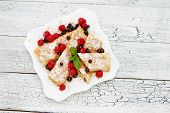 image of crepes  - Tasty crepes on wooden table studio shot - JPG