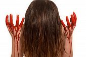 stock photo of life after death  - woman after performing abortion with her hands in blood - JPG