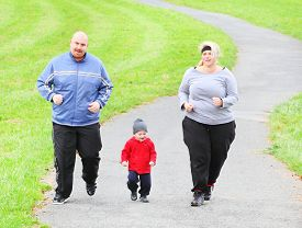 stock photo of obese children  - Overweight parents with her son running together - JPG