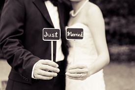 picture of married  - Bride and groom holding a just married sign in black and white - JPG