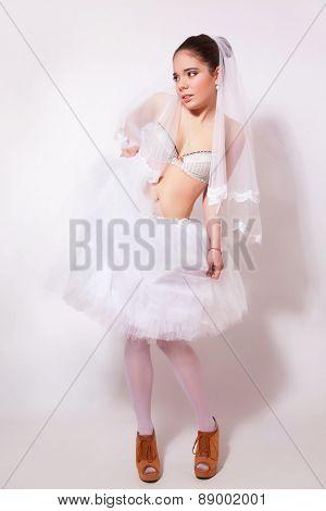 Bride In A Skirt, Underwear And Veil