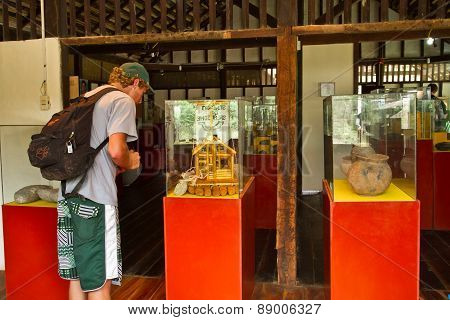 Unidentified tourists in Agua Blanca Comune Museum, Machalilla National Park, Ecuador