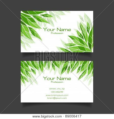 Business card with green leaves. Vector template