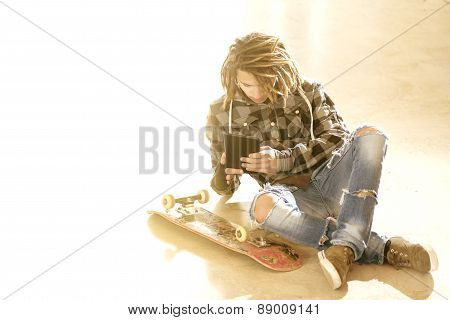 Young Guy Sitting With Digital Tablet Warm Filter Applied