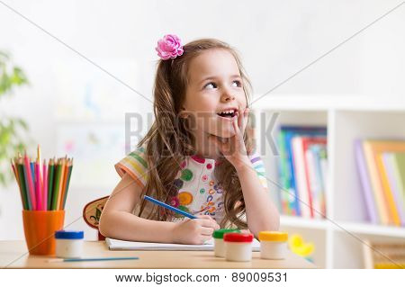 dreamy kid girl with pencils