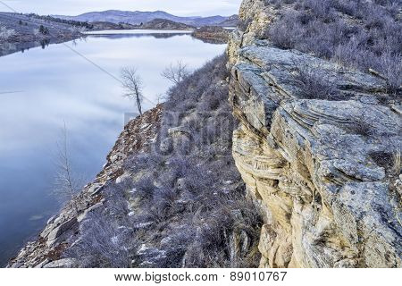 winter dusk over mountain lake with sandstone cliffs - Horsetooth Reservoir near Fort Collins, Colorado