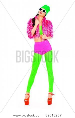 Full length portrait of a trendy girl in vivid colourful clothes and sunglasses. Party style. Bright fashion. Optics, eyewear. Studio shot.