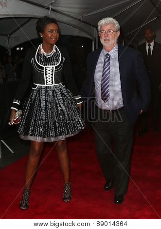 NEW YORK-APR 21: Director George Lucas (R) and wife Mellody Hobson attend the 2015 Time 100 Gala at Frederick P. Rose Hall, Jazz at Lincoln Center on April 21, 2015 in New York City.