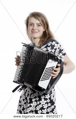 Smiling Teenage Girl Stands In Studio With Accordion