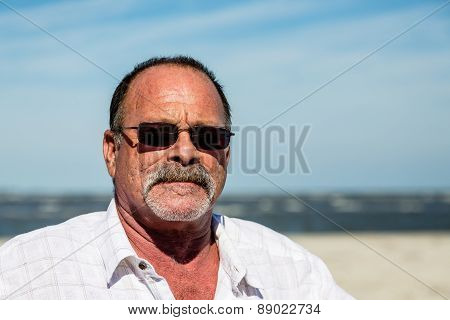 Old Guy In White Shirt With Sunglasses