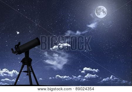 Telescope silhouette against the starry sky. Elements of this image furnished by NASA