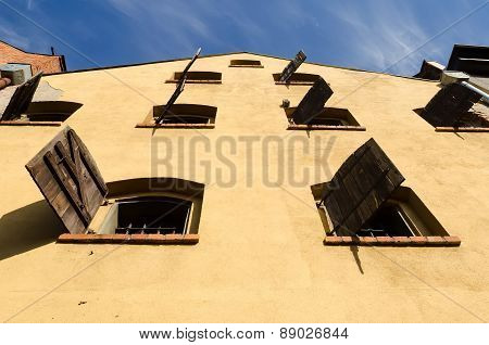 Old granary with wooden shutters in Torun Poland.