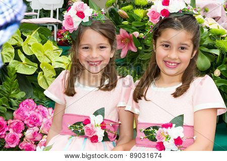 FUNCHAL MADEIRA - APRIL 20 2015: Two smiling girls in floral costumes at the Madeira Flower Festival