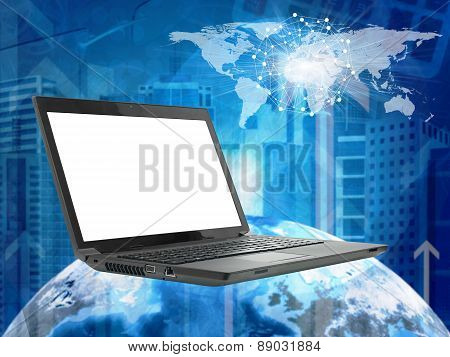 Laptop with earth model on abstract cityscape