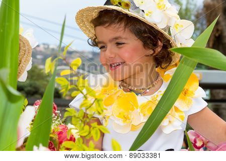 FUNCHAL MADEIRA - APRIL 20 2015: Child with flower headdress at the Madeira Flower Festival Funchal