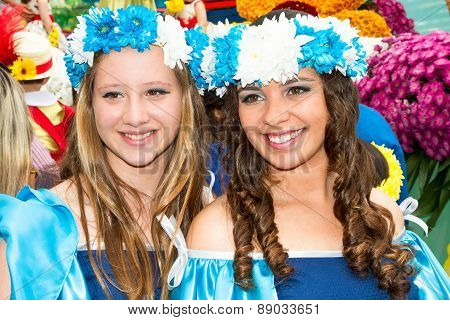 FUNCHAL MADEIRA - APRIL 20 2015: Two young woman with floral wreath in her hair at the Madeira Flowe