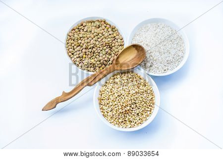 Cereals Rice, Lentil, Wheat And Wooden Empty Spoon