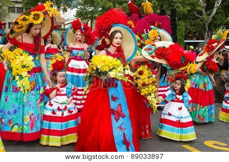 FUNCHAL MADEIRA - APRIL 20 2015: Young women and children with colorful floral costumes at the Madei