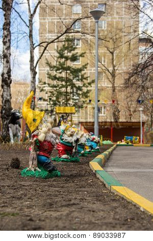 Garden Gnomes Figures In The Courtyard Of The Kindergarten