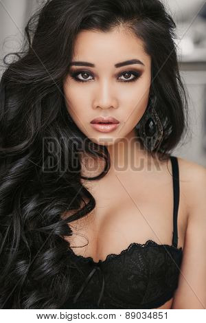 portrait of a beautiful young brunette with dark eyes Vietnamese
