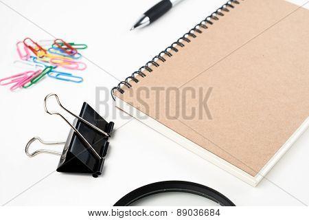 education stuff on white background.glassesmoneypaper clippen