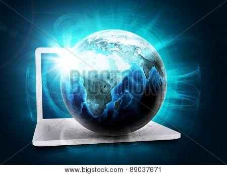 Earth model in haze on laptop