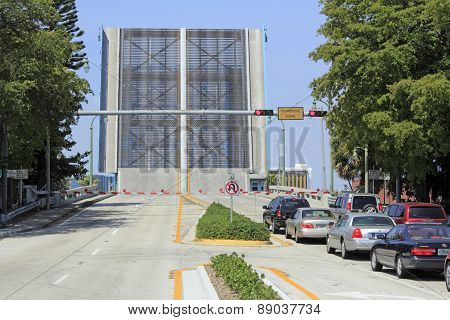 Raised Drawbridge With Vehicles Waiting