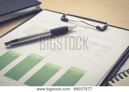Business And Financial Report With Pen On Wooden Table.document Is Mockup