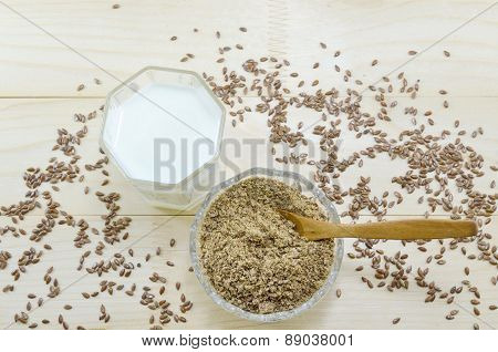 Linseed In The Bowl And A Glass Of Milk