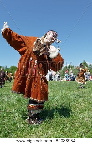 Girl In Clothing Aborigine Of Kamchatka Dancing On The Green Grass. Kamchatka, Russia