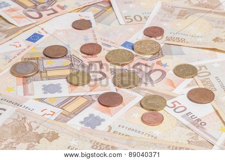 Coins Over Fifty Notes