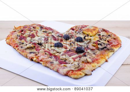 Heart Shaped Pizza On Table