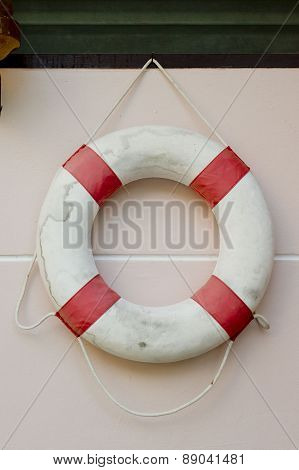 Life Vest On White Wall.