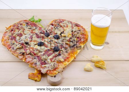 Heart Shaped Pizza And A Glass Of Beer