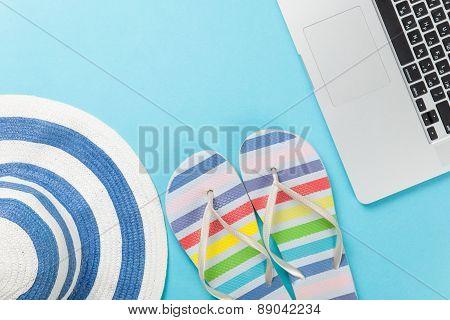 Hat With Flip Flops Near Notebook