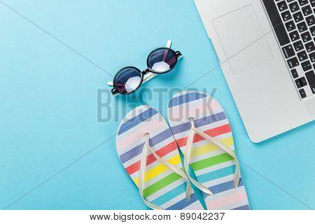 Sunglasses Near Flip Flops And Notebook