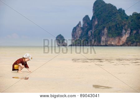 Child Playing On Fine Sand