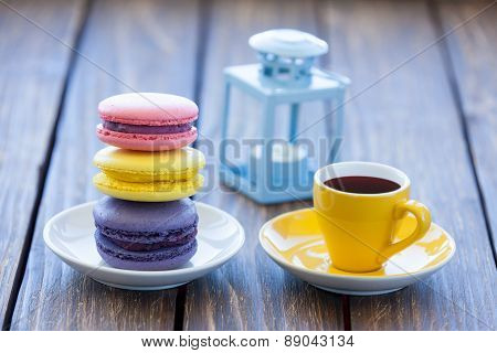 Cup Of Coffee And Macarons With Decorate Lamp