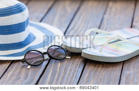 Sunglasses And Hat With Flip Flops