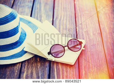 Sunglasses And Hat With Notebook
