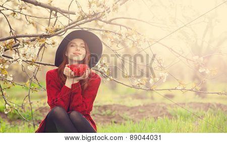 Women In Red Sweater And Hat With Cup